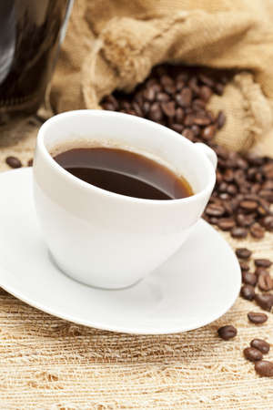 Black Coffee with coffee beans on a background Stock Photo - 14230576