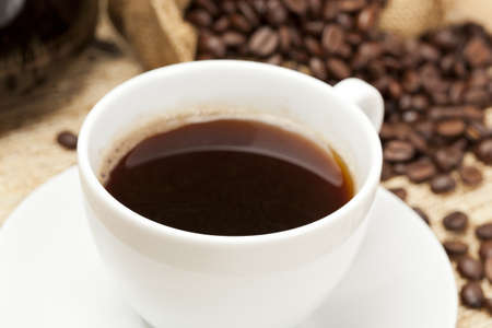 Black Coffee with coffee beans on a background Stock Photo - 14228918