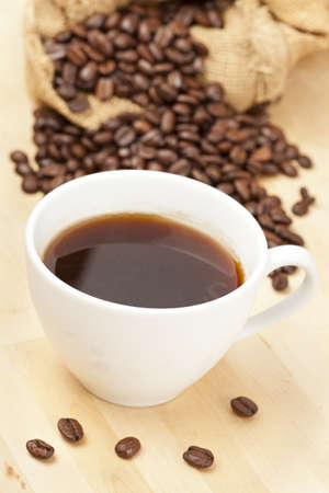 Black Coffee with coffee beans on a background Stock Photo - 14228920