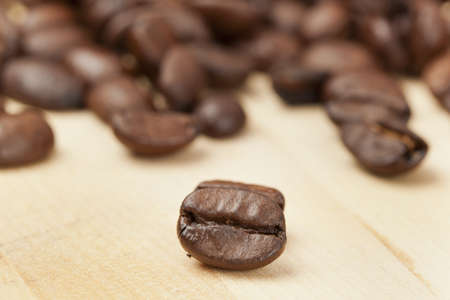 Black Organic Coffee Beans on a background Stock Photo - 14228912