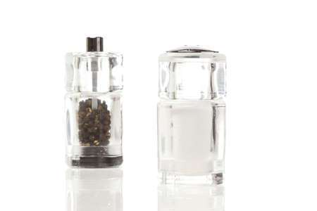 Clear Salt and Pepper Shakers on a background photo