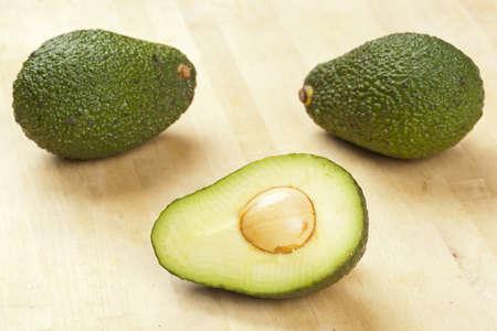 A fresh Organic Green Avocado on a background photo