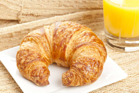 A Freshly Baked Croissant made for breakfast Фото со стока
