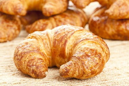 croissant: A Freshly Baked Croissant made for breakfast Stock Photo