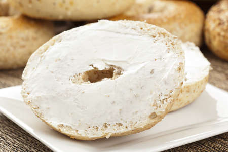 Homemade Fresh Whole Grain Bagel with cream cheese Stock Photo - 14680759