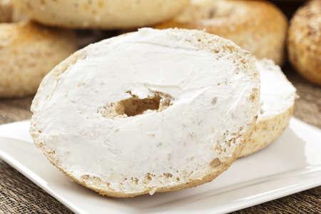 Homemade Fresh Whole Grain Bagel with cream cheese Stock Photo - 14680759