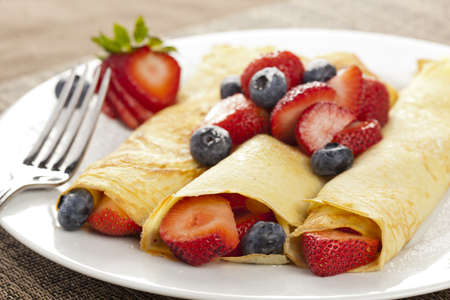 crepes: Fresh Homemade Rolled Strawberry Crepes with blueberries