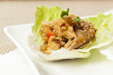 Homemade Asian Chicken Lettuce Wraps on a background