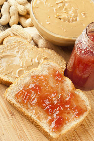 Homemade Peanut Butter and Jelly Sandwich against a background photo
