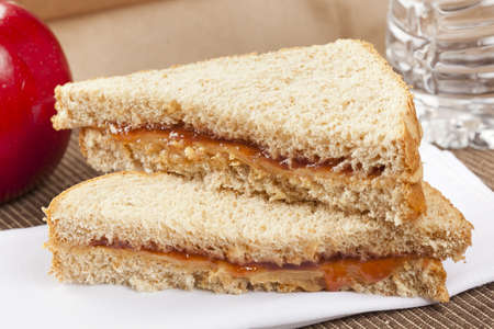 apple sack: Peanut Butter and Jelly Sack Lunch with water and apple