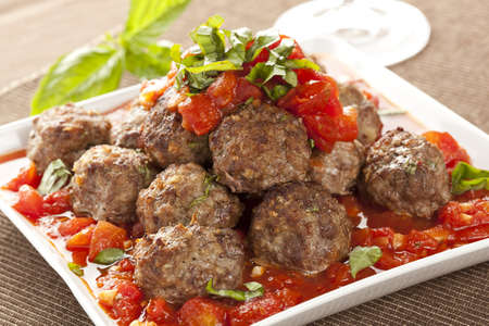 Homemade Meatballs in Red Tomato Sauce on a background photo