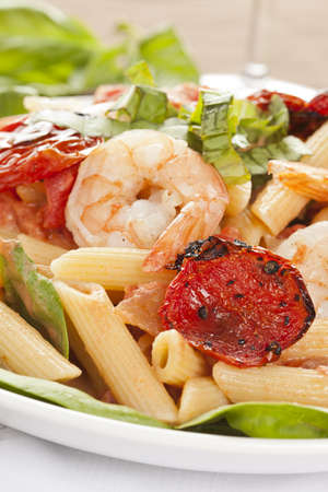 Homemade Shrimp Pasta with tomatoes and green spinach Stock Photo - 14808341