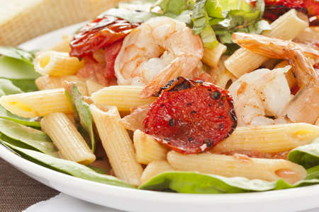 Homemade Shrimp Pasta with tomatoes and green spinach photo