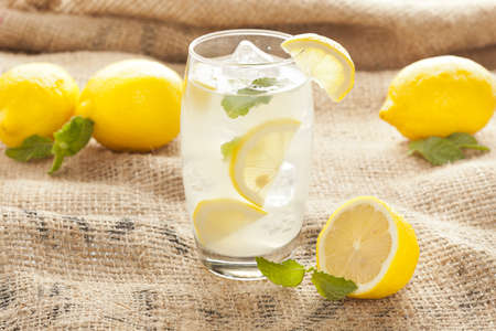Fresh Organic Lemonade with mint leaves on a background photo