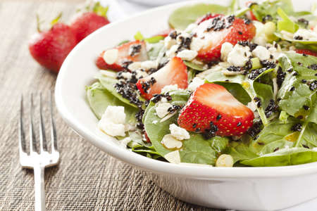 green leafy vegetables: Fresh Homemade Strawberry Spinach Salad with sesame seed salad