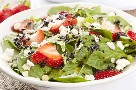 Fresh Homemade Strawberry Spinach Salad with sesame seed salad photo
