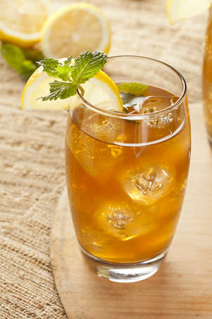 Refreshing Iced Tea with Lemon against a background Reklamní fotografie