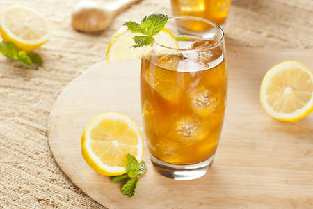 Refreshing Iced Tea with Lemon against a background Reklamní fotografie - 14876689