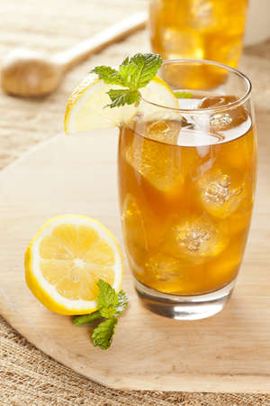 Refreshing Iced Tea with Lemon against a background Stock Photo