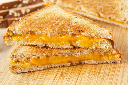 Traditional Homemade Grilled Cheese Sandwich on Whole Wheat Bread photo