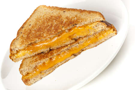 melted cheese: Traditional Homemade Grilled Cheese Sandwich on Whole Wheat Bread Stock Photo