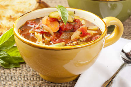 soup bowl: Hot Homemade Minestrone Soup with fresh vegetables