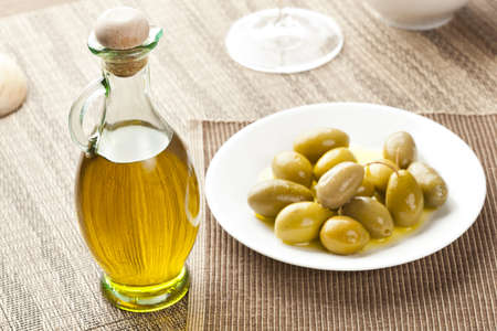 cooking oil: Traditional Homemade Olive Oil on a background