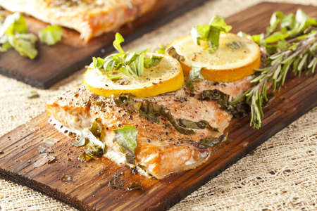 Fresh Grilled Salmon on a wooden plank photo