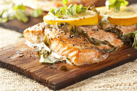 cooked fish: Fresh Grilled Salmon on a wooden plank