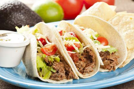 mexican food: Fresh Homemade Shredded Beef Tacos with organic ingredients Stock Photo