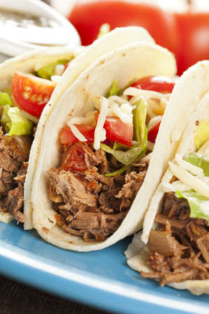tacos: Fresh Homemade Shredded Beef Tacos with organic ingredients Stock Photo