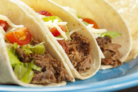 taco: Fresh Homemade Shredded Beef Tacos with organic ingredients Stock Photo