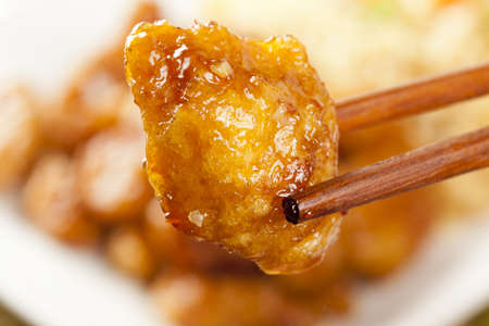 Homemade Orange Chicken with Rice on a background photo
