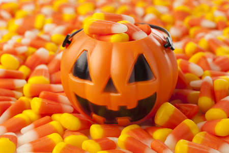 Halloween Striped Candy Corn against a background photo