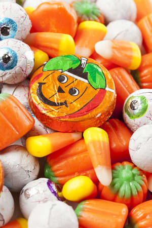 Spooky Orange Halloween Candy against a background photo