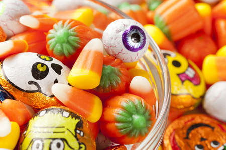 candy corn: Spooky Orange Halloween Candy against a background