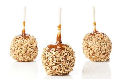 taffy apple: Homemade Taffy Apple with Peanuts against a back ground