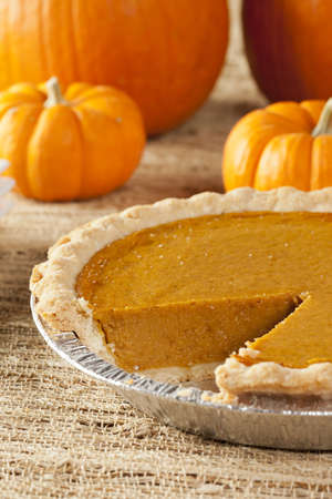 feast: Fresh Homemade Pumpkin Pie made for Thanksgiving Stock Photo