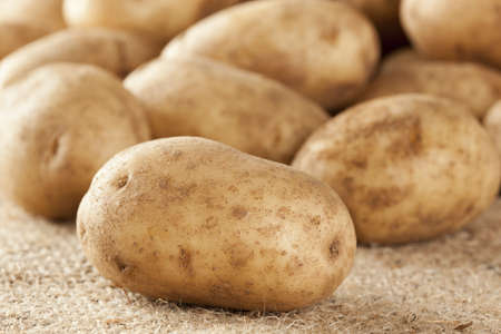 russet: Fresh Organic Whole Potato on a background Stock Photo