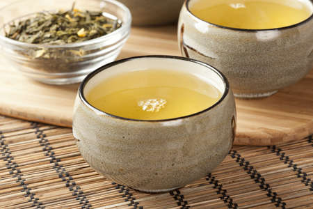 Organic Green Tea in a ceramic bowl photo