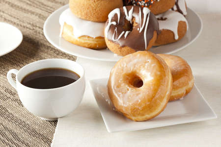 round: Fresh Homemade Donuts and Coffee against a background