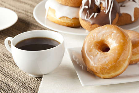 donut shape: Fresh Homemade Donuts and Coffee against a background