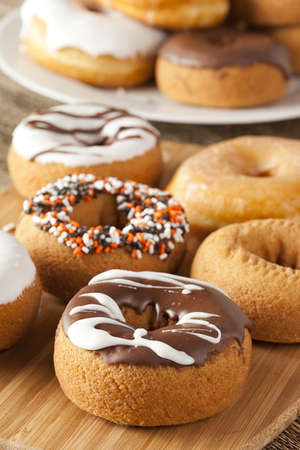 junk: Fresh Homemade Donuts against a background Stock Photo