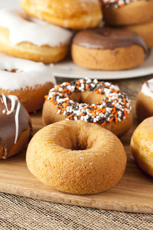 donut shape: Fresh Homemade Donuts against a background Stock Photo