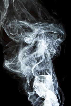 Whispy White Smoke against a black background