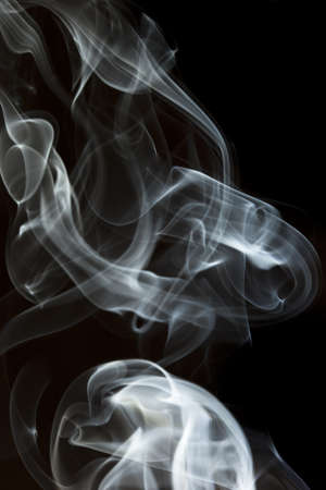 Whispy White Smoke against a black background