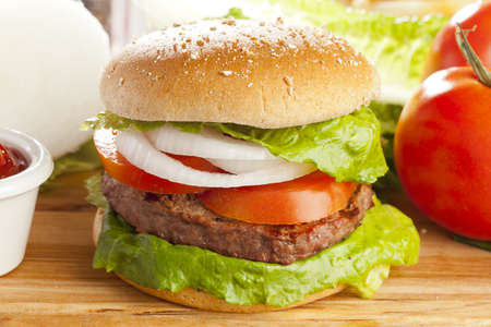 Homemade Organic Hamburger with Lettuce and Tomato photo