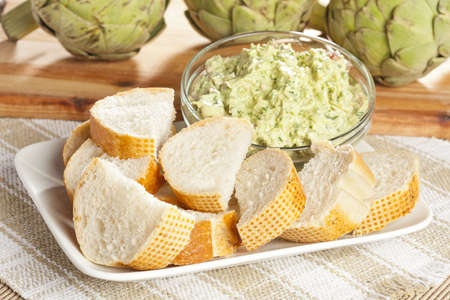 Fresh Organic Artichoke Dip with fresh Bread photo