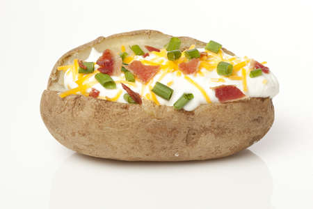 spud: Hot Baked Potato with chives, cheese, and sour cream Stock Photo