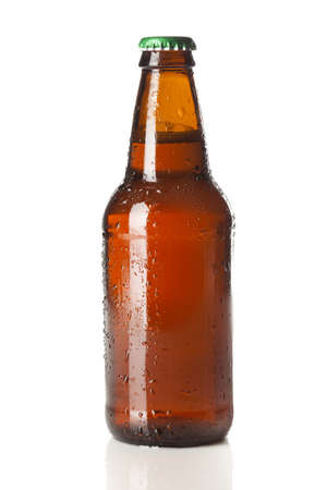brown bottle: Refreshing Ice Cold Beer against a background Stock Photo